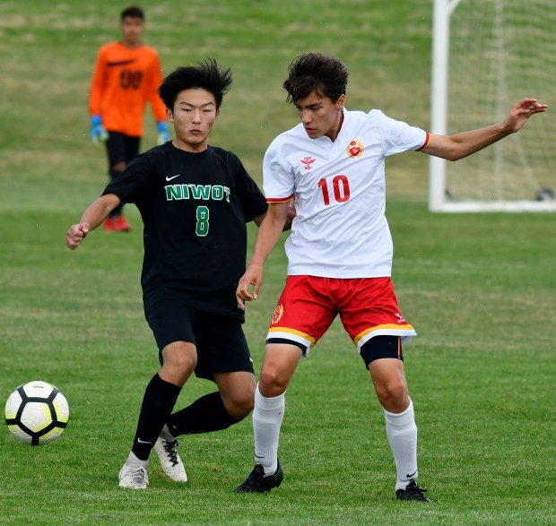 Niwot's Daniel Cho, left, and Skyline's ...