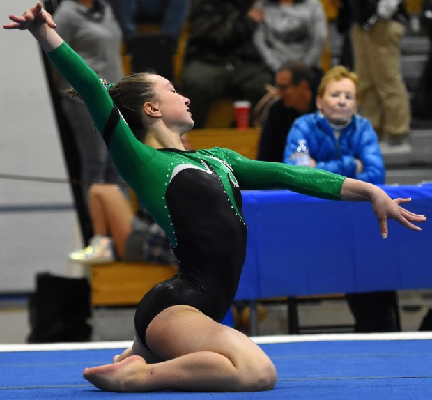 Niwot's Mia Curry holds a pose ...