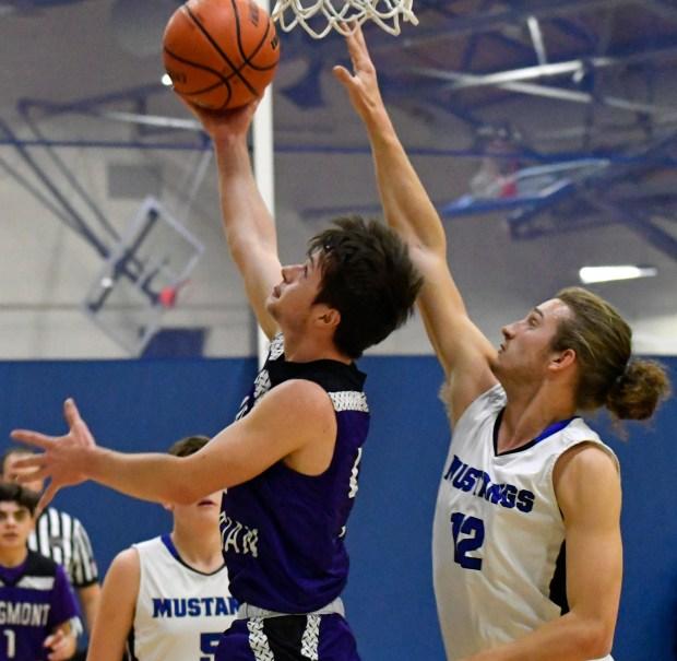 Nick Holst of the Longmont Christian Warriors boys basketball team