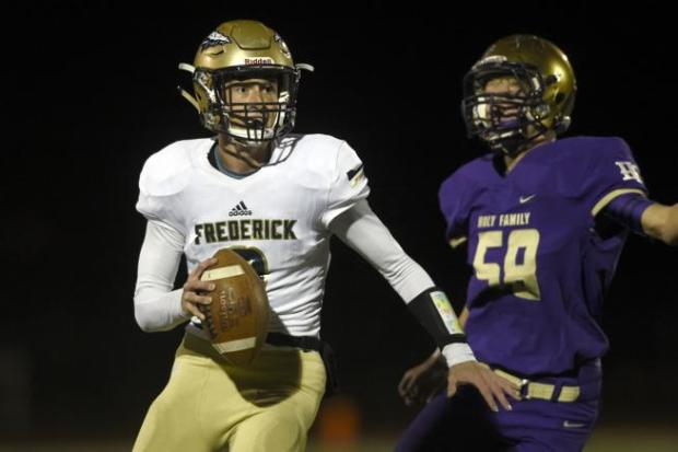 Frederick quarterback Jake Green scrambles away ...