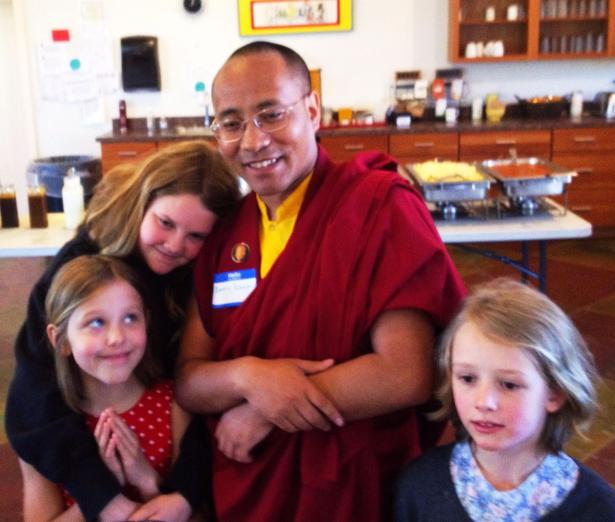Lama Karma before leading lunch offering prayer