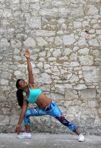 Triangle pose warrior pose yoga blue leggings yoga outdoors light blue bra with padding