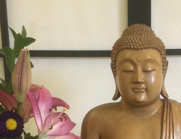 Peaceful interior of Bodhi Oak with Buddha
