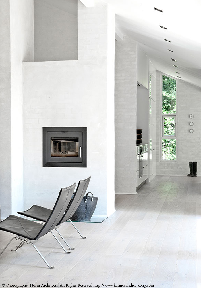 white interiors, black fireplace