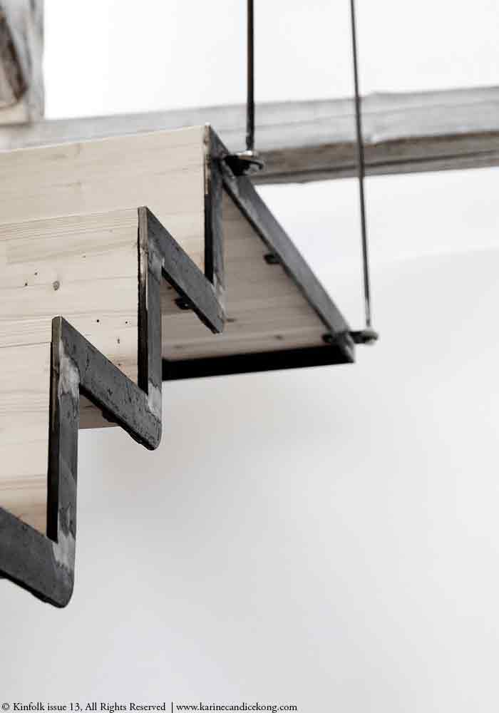 Detail of stairs in blacksmith studio renovated by 3 Danish Architects
