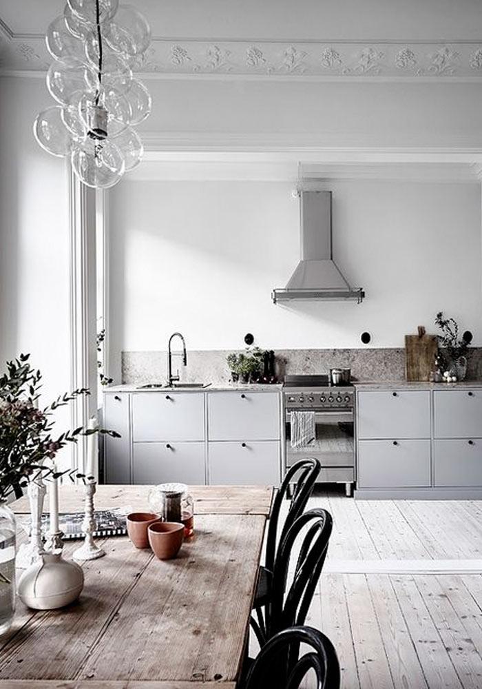 grey kitchen & white floorboards