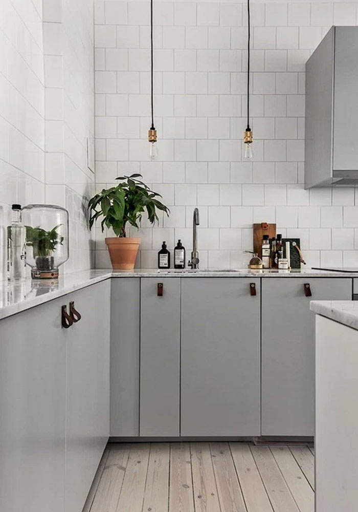 grey kitchen with leather handles