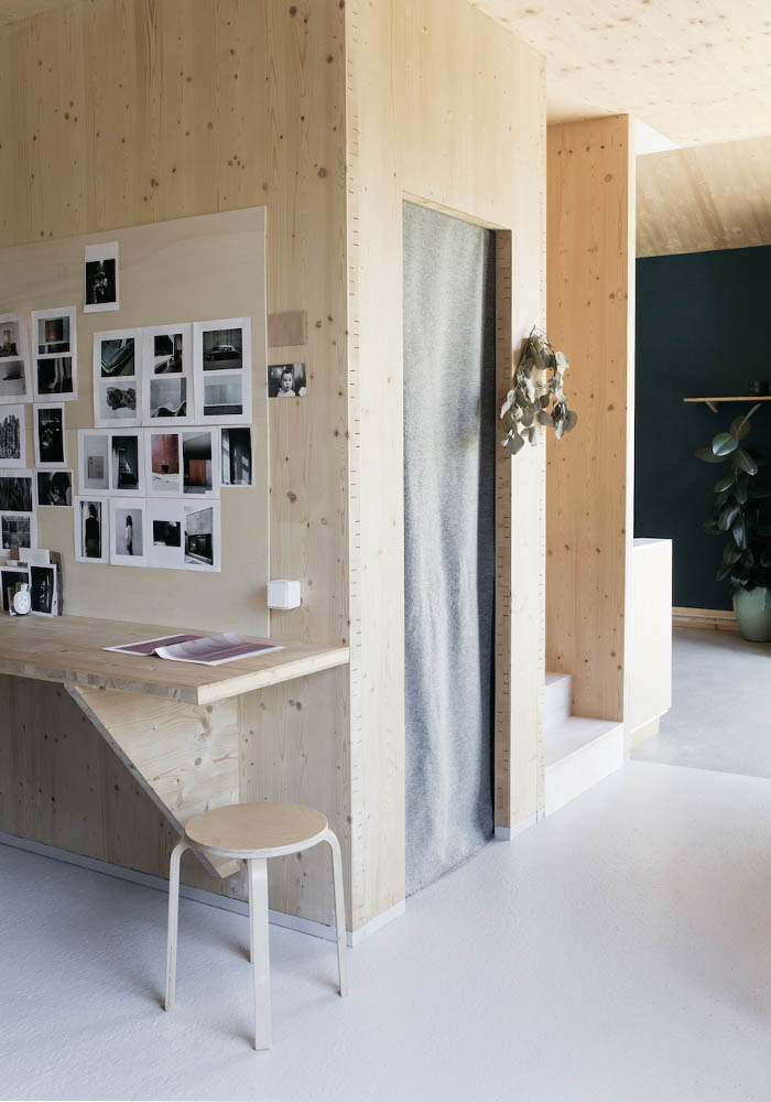 Plywood walls in the wooden house of a Fashion Designer
