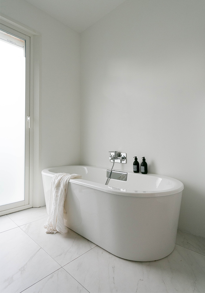 A white, minimalist bathroom makeover