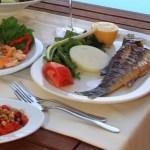 Plates of food on a table at the Turgutreis Marina Turkey