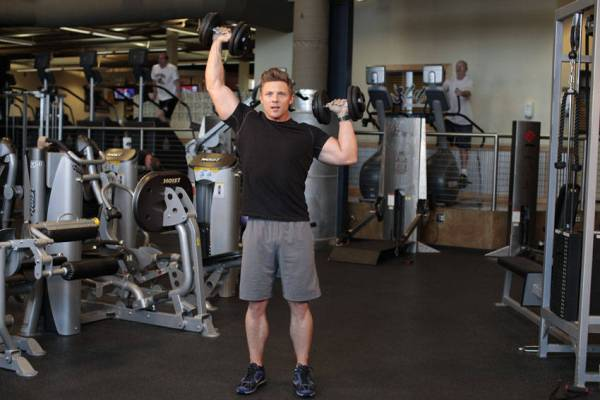 Standing Alternating Dumbbell Press Exercise Guide and Video