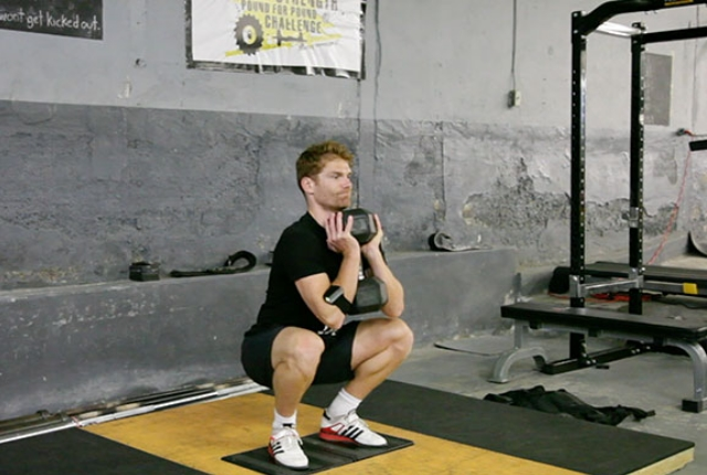Static Squat with dumbbell extension