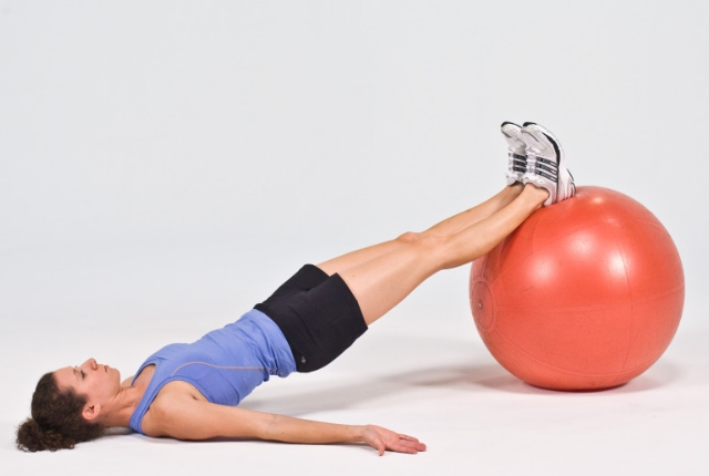 Leg Extensions Using Medicine Ball