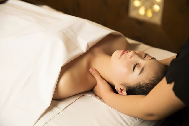Portrait of Beautiful Asian Woman having relaxing massage in Spa