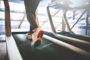 Girl Running on Treadmill