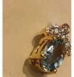Aquamarine gemstone earrings topped with diamond clusters in a 14 kt. Yellow gold setting. Chain not included. $380