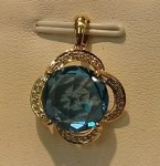 XXXBlue Topaz (13ct.) gemstone pendant with a diamond surround. $725