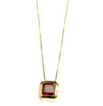 Square cut 3ct. Garnet in a handsome 14kt. yellow gold pendant setting on an 18″ chain. $389