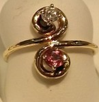 XXXPink Tourmaline and Diamond (.07ct.) ring in an infinity setting of 14kt. yellow gold. $250