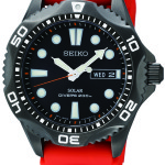 Seiko Men's Seiko SNE245 Solar Diver. Easy-to-read black dial. Japanese quartz movement with analog display and protective crystal dial window. Features include orange urethane band, day and date. Water resistant to 660 feet. SNE245.