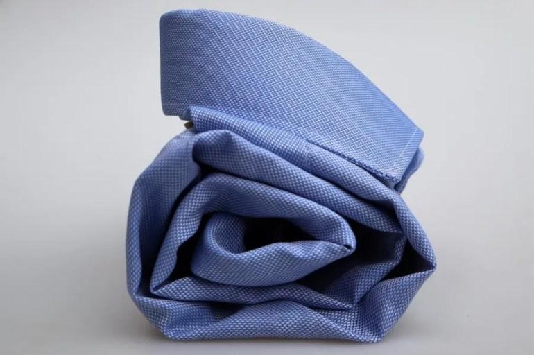 Hoe rol je een overhemd kreukvrij op