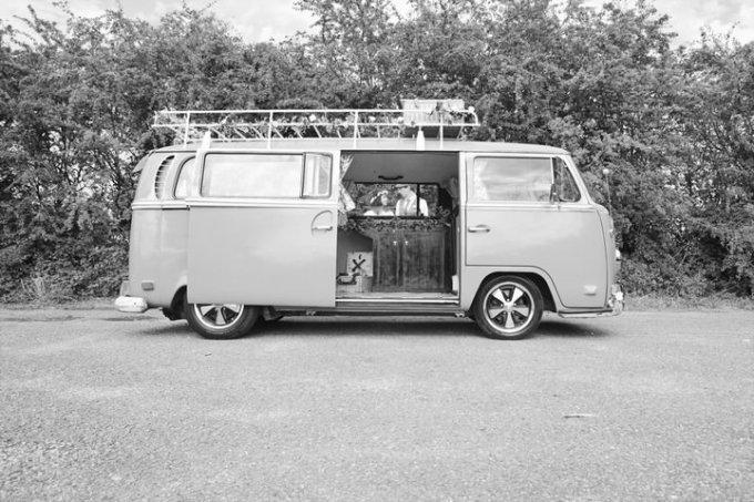 VW Camper van with wedding couple