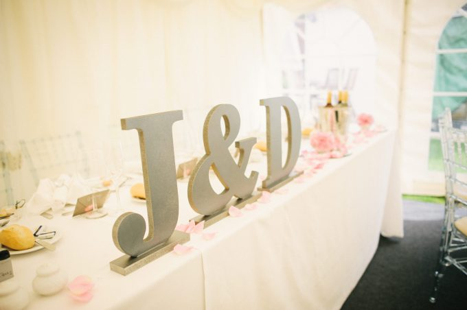 J & D wedding sign on top table