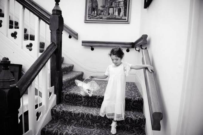 flower girl walking down stairs