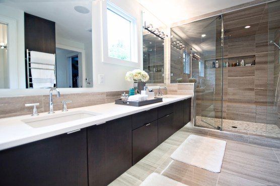 Livingstone ensuite completed with Wooden White marble installed on the floor, shower walls and backsplash. Majestic Pebbles mosaic installed in the shower base.