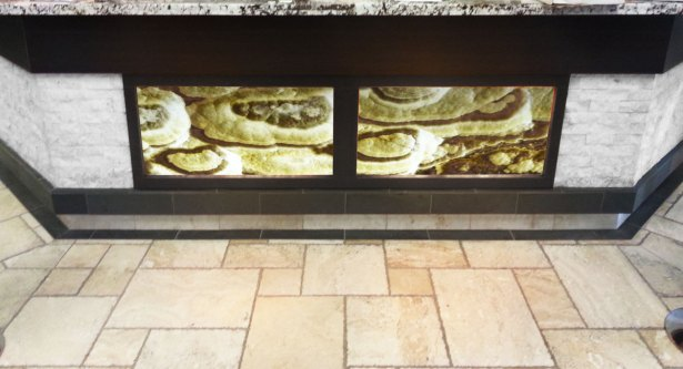 Grey Cloud Bolder Stone Panel - Onyx Series - installed and backlit in a counter
