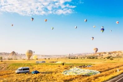 Hot air balloons landing in Cappadocia