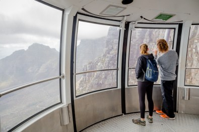 Enjoying the views from the cable car on our way down from Table Mountain