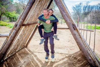Adam and I test the strength of ostrich eggs at Safari Ostrich Farm in Oudtshoorn