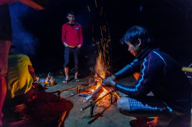 Oxalis team hard at work making a delicious dinner in the rain on our Tu Lan Jungle Challenge Tour