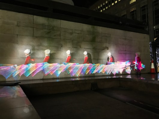 Nadia painting withLuma Paint Public Light Graffiti as Lightpainting, London Winter Lights, Canary Wharf, 2017