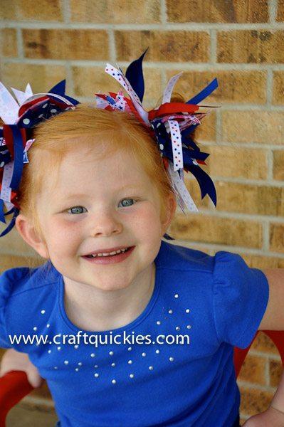 girl wearing firecracker hair bows