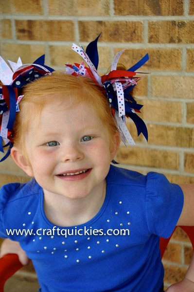 girl wearing firecracker hair bows