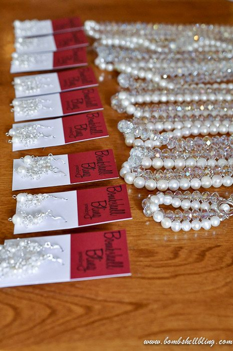 crystal and pearl necklace on table with earrings