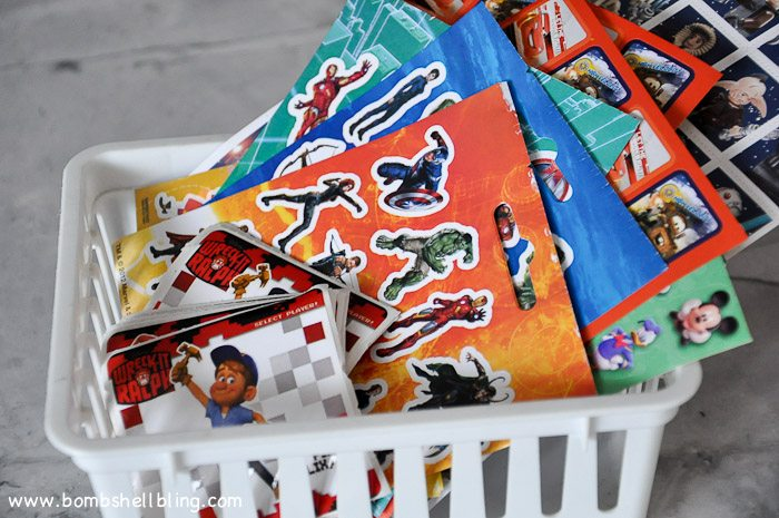 Stickers in white basket at disney birthday party