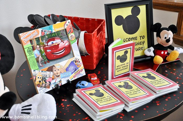 Adventure passports on table at disney birthday party