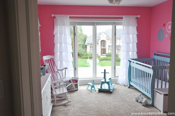 I adore this sweet nursery for a baby girl!