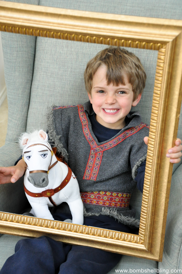 Boy holding gold frame at Bippity Boppity Boutique Party