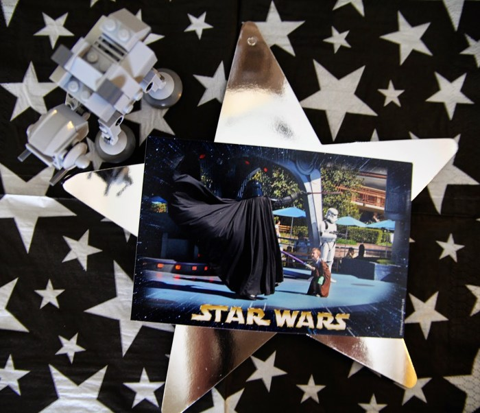 Star Wars Lego table centerpiece photo of boy fighting Vader on silver star