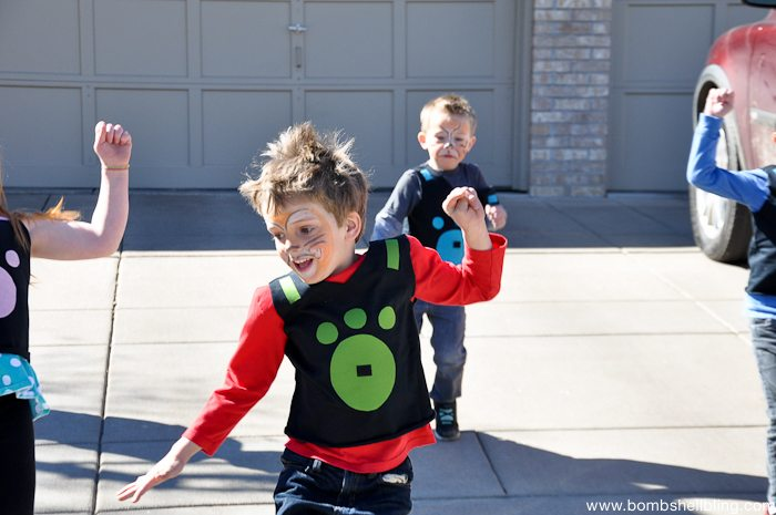 Kids jumping in driveway close up at Wild Kratts Birthday Party