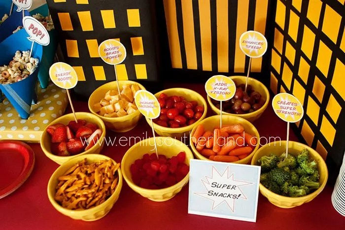 food in yellow bowls on superhero birthday party table