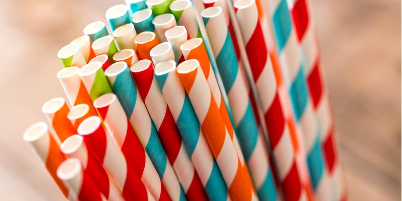 A group of paper straws in different coloured patterns. Used to display plastic straw alternatives.