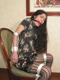 Cute Brunette tied up and gagged in sexy Dress and Heels