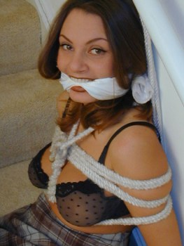 Horny Housewives look happy bound and gagged