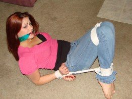 Hot young Girlfriend is hogtied and gagged with Scarf at Home