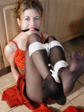 Sexy young Housewife is tied up and gagged in the Kitchen